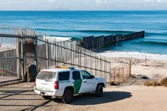 Border Patrol Vehicle Near U.S./Mexico Border Wall at Pacific Ocean. SAN DIEGO, CALIFORNIA - NOVEMBER 4, 2017: A Border Patrol vehicle patrols near the border stock photography