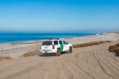 Border Patrol Vehicle Patrolling at Border Field State Park Beach in San Diego. SAN DIEGO, CALIFORNIA - NOVEMBER 4, 2017:  A Border Patrol vehicle patrols Border Royalty Free Stock Photography