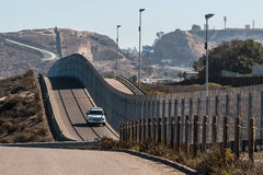 Border Patrol Vehicle Patrolling San Diego-Tijuana Border. Border Patrol vehicle patrolling along the fence of the international border between San Diego Stock Image