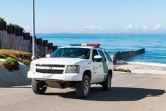 Border Patrol Vehicle Patrols International Border Between San Diego and Tijuana. SAN DIEGO, CALIFORNIA - NOVEMBER 4, 2017:  A Border Patrol vehicle patrols the Royalty Free Stock Photography