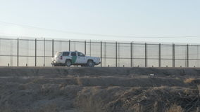 Border Patrol Vehicles Parked Near the US and Mexico Border