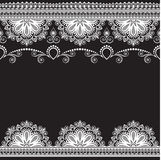 Border pattern elements with flowers and lace lines in Indian mehndi style for card and tattoo isolated on black background. Stock Photography