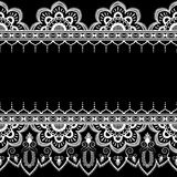 Border pattern elements with flowers and lace lines in Indian mehndi style isolated on black background. Stock Image