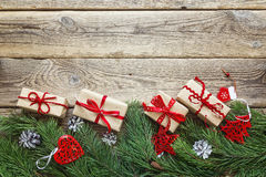 Border from the pine branches, Christmas decorations and gift bo Stock Image