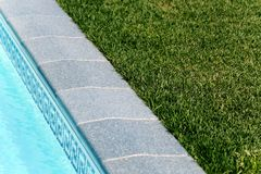 Border between pool and a lawn Stock Photos