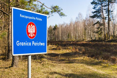 Border post with the emblem of the Polish. Stock Photo