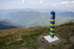 Border post in mountains. Border post on peak mountains Royalty Free Stock Image