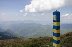 Border post in mountains. Border post on peak mountains Royalty Free Stock Photo