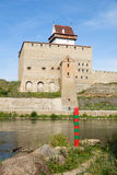 Border post on the Narva River. Border between Russia and Estonia on the River Narva. Focus at the border post Stock Photo