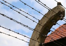 Border of a prison with barbed wire. Border of an ancient prison of second world war with barbed wire Stock Photo