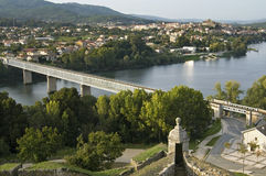 Border river, bridge, between Portugal and Spain. Panoramic view over the border river Minho, the bridge that connects the Spanish city Tui with the Portuguese Stock Images
