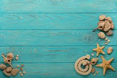 Border with rope, stones, sea shells and starfish on a turquoise Stock Photos
