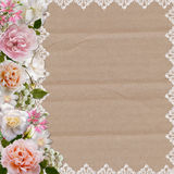 Border of roses and lace on a cardboard background Stock Photos