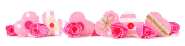 Border of rustic pink Valentines heart-shaped gift boxes and roses Royalty Free Stock Photos