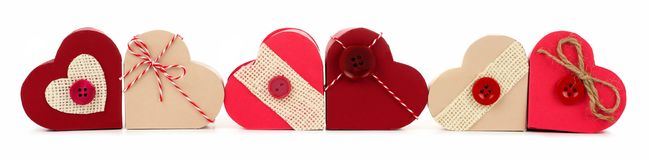 Border of rustic Valentines heart-shaped gift boxes isolated Royalty Free Stock Photos