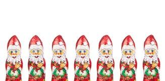 Border of Santa Claus chocolate figures  xmas decoration Royalty Free Stock Image