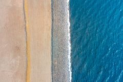Border between sea and land. Stones mound of sand and water, top aerila view stock photos
