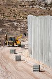 Border security: building the Israel - Palestine concrete wall. Controversial border security: a front loader working on the concrete Israeli separation or royalty free stock photo