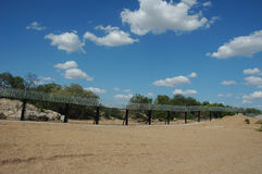 Border security through a river bed. River bed next to security fence between Zimbabwe and South Africa taken from the South African side Stock Image