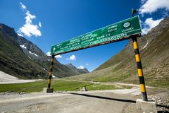 Border sign at the beautiful mountain. View on the way to Rangdum, Kashmir state, India royalty free stock photo