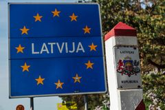 Border sign of Latvia located on the border between Latvia and Lithuania. General Schengen country border sign of Latvia located on the border between Latvia stock image