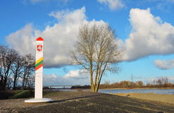 Border sign in Rusne island, Lithuania. Lithuanian border sign near Atmata river in Rusne island, Lithuania stock photo