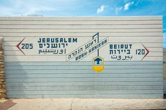 Border sign, showing distance to Jerusalem and Beirut, in Rosh Hanikra - popular tourist site in Israel. On the border with Lebanon royalty free stock photos