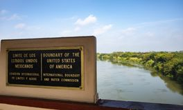 The border sign United States and Mexico. Rio Grande river on the border between United States and Mexico in Texas stock photography