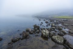Border of Sorvagsvatn Lake covered with mist
