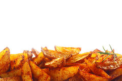 Border of spicy fried potato wedges Royalty Free Stock Photo