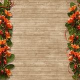 Border of spring flowers on a wooden background Royalty Free Stock Image