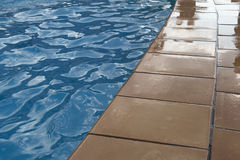 Border of a swimming pool at the evening Royalty Free Stock Image