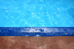 Border and swimming pool Royalty Free Stock Image