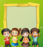 Border template with four kids on the grass stock illustration