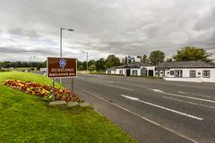 Border to Scotland with sign `Scotland welcomes you`, on the road in Great Britain stock photo