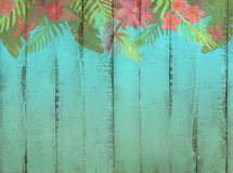 Border with tropical jungle pattern on sea blue color wooden bac. Border with abstract tropical jungle pattern on sea blue color wooden background Royalty Free Stock Image