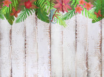 Border with tropical jungle pattern on white wooden background Stock Images