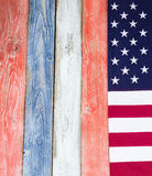Border of USA flag on rustic painted wooden boards in national c Stock Photos