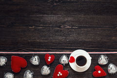 Border from Valentine hearts and cup of coffee on the dark woode Stock Photography