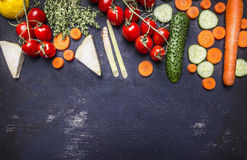 Border  Various fruits and vegetables with herbs cherry tomatoes on a branch vegetarian food place for text on wooden rustic backg Stock Images