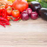 Border  of  vegetables. Blank wooden table  with border  of colorful vegetables Stock Photo