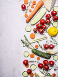 Border Vegetarian food tomatoes on a branch carrot cucumber lemon herbs place for text on wooden rustic background top view Stock Images