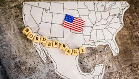 Border wall business concept with United States and Mexico map. Border wall business concept with border wall letter blocks placed over the US and Mexico border stock image