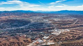 Border Wall at Nogales. Border Wall aerial view looking into Nogales, Mexico from Nogales, Arizona, USA stock photography