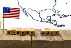 Border Wall USA concept with American flag on white background and wooden board. Protection. Government. Politics stock photo