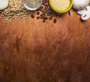 Border with walnuts, raisins, mushrooms couscous seasoning on wooden rustic background close up top view banner for website space Royalty Free Stock Images