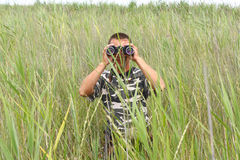 A border war is looking through binoculars Stock Photography