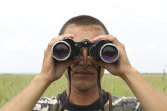 A border war is looking through binoculars Stock Photos