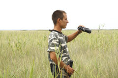 A border war is looking through binoculars Stock Images