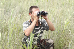 A border war is looking through binoculars Royalty Free Stock Photography